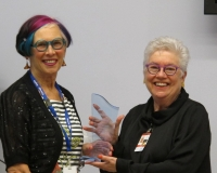 Leah Hollins, IH Chair, presents award, joins Auxiliary